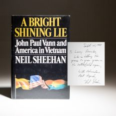 First edition of A Bright Shining Lie by Neil Sheehan, inscribed to Senator Larry Pressler.