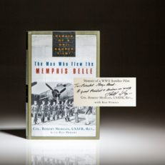 Signed first edition of The Man Who Flew The Memphis Belle, inscribed to President George H.W. Bush