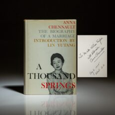 Signed copy of A Thousand Springs by Anna Chennault, inscribed to New York Times columnist William Safire.
