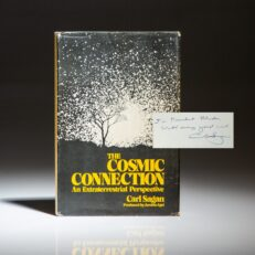 First edition of The Cosmic Connection by astronomer Carl Sagan, inscribed to Cornell President Frank H.T. Rhodes.