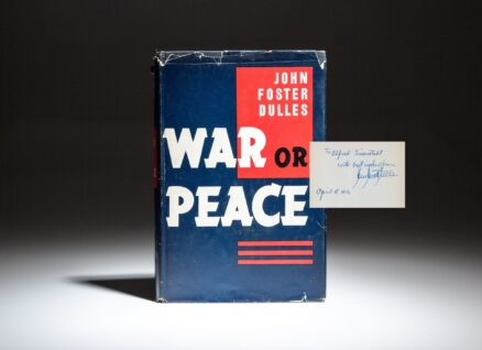 Signed first edition of War Or Peace by John Foster Dulles, inscribed to Life Magazine photographer, Alfred Eisenstaedt.