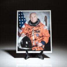 Photograph of astronaut John Glenn inscribed to Hollywood legend, Mickey Rooney and his wife, Jan Rooney.