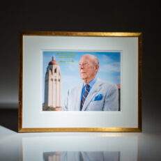 Photograph of former Secretary of State, George P. Shultz, inscribed to media mogul, Rupert Murdoch.