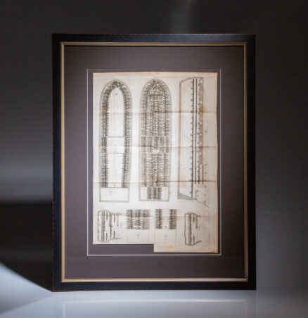A framed cross-sectional illustration of a slave ship, based on the British slave ship Brookes, showing placement of slaves in the various parts of the ship.