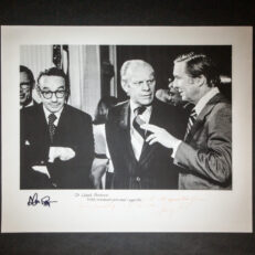 Photograph of President Gerald R. Ford, Senator Lloyd Bentsen and Alan Greenspan, inscribed by President Ford to Senator Bentsen. Additionally signed by Alan Greenspan. This photograph was taken on September 5th, 1974 at the Conference on Inflation, held in the East Room of the White House.