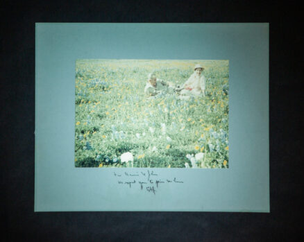 Photograph of President Lyndon Johnson and Lady Bird Johnson relaxing in a field of wildflowers, inscribed by President Johnson to the CEO of Standard Oil of Indiana, John E. Swearingen and his wife, Bonnie Swearingen.