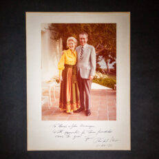 Photograph of President Richard Nixon and First Lady Pat Nixon at La Casa Pacifica, inscribed to John and Bonnie Swearingen.