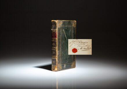 First edition of Het Leven en Karakter van den Admiraal Jhr. Jan Hendrik van Kinsbergen by M.C. van Hall. Includes a signed presentation slip from the author.