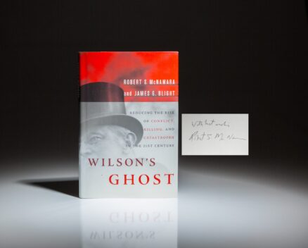 Signed by former Secretary of Defense, Robert S. McNamara, a first edition of Wilson's Ghost: Reducing the Risk of Conflict, Killing and Catastrophe in the 21st Century.