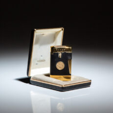 White House Ronson Lighter, a gift from President Richard Nixon. Presidential seal on side panel, in gold.
