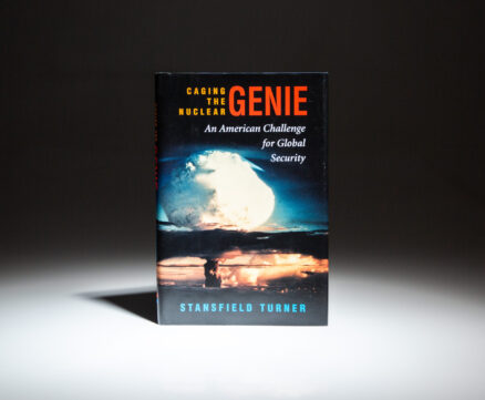 First edition, fourth printing of Caging the Nuclear Genie: An American Challenge for Global Security, signed by Stansfield Turner.