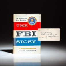 First edition of The FBI Story: A Report to the People by Don Whitehead, inscribed by FBI Director J. Edgar Hoover to the founder of the AFL-CIO, George Meany.