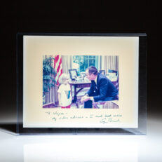 Signed White House photograph of President George H.W. Bush with his granddaughter, inscribed to American businessman, Wayne Huizenga.