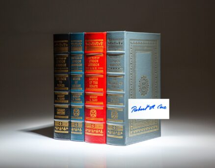 Four volumes of The Years of Lyndon Johnson from The Easton Press, signed in Volume I by historian Robert A. Caro.