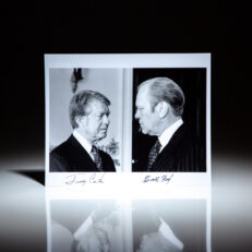 Signed photograph of President Gerald R. Ford and President-elect Jimmy Carter at the White House.