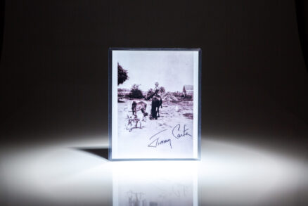 Signed photograph of a young President Jimmy Carter riding a pony, named Lady.