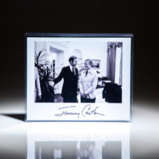 Signed photograph of President Jimmy Carter with Senator Joe Biden in the Oval Office on October 19th, 1979.