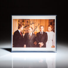 Signed photograph of President Jimmy Carter, standing next to King Hussein of Jordan, the Last Shah of Iran, Mohammed Reza Pahlavi, and his wife, Farah Pahlavi.