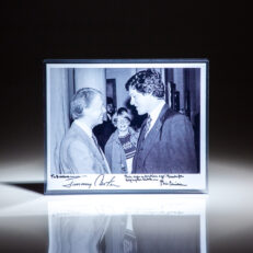 Inscribed photograph of President Jimmy Carter greeting Governor-elect Bill Clinton at the White House.