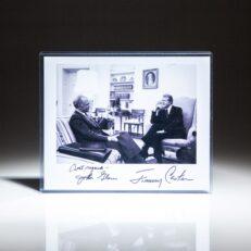 Signed photograph of President Jimmy Carter with Senator John Glenn in the Oval Office.
