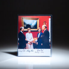 Signed photograph of President Gerald R. Ford and President-elect Jimmy Carter, First Lady Betty Ford and future First Lady Rosalynn Carter, at the White House.