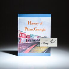 History of Plains, Georgia, compiled by the Plains Historical Preservation Trust. This copy is signed by President Jimmy Carter.