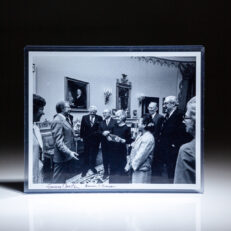 Photograph of President Carter meeting with the Justices of the Supreme Court and their wives, signed by President Jimmy Carter and Chief Justice Warren E. Burger.