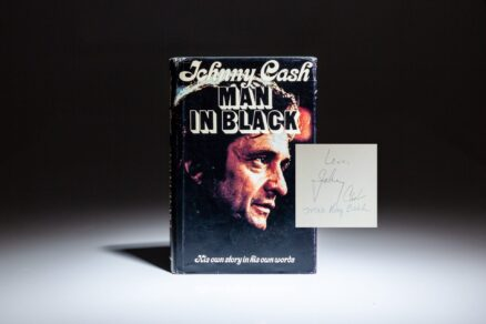 The autobiography of Johnny Cash, Man in Black, signed by the legendary musician, Johnny Cash, and his mother, Mrs. Ray Cash.