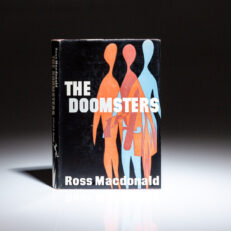 First edition, first printing of The Doomsters by Ross Macdonald.