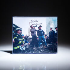 Photograph of President George W. Bush and New York City fireman Bob Beckwith, inscribed by Beckwith.
