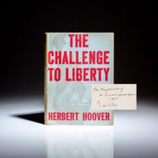 First edition, third printing of The Challenge to Liberty, with a unique inscription by former President Herbert Hoover.